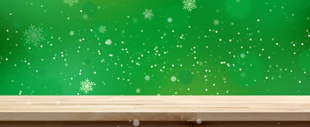 白い雪、パノラマバナーと緑のボケ背景に木製テーブルトップ Premium写真