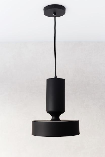 Подвесные светильники из черного металла, украшенные золотой фольгой. Premium Фотографии