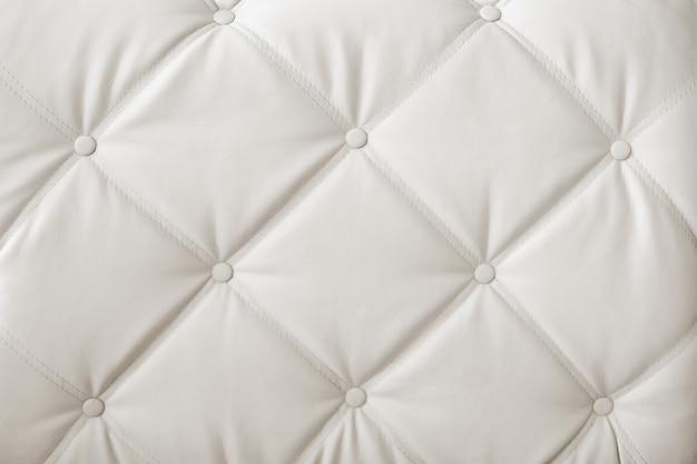 クラシックな白とグレーの革の質感を持つ豪華でモダンなスタイルの背景 Premium写真