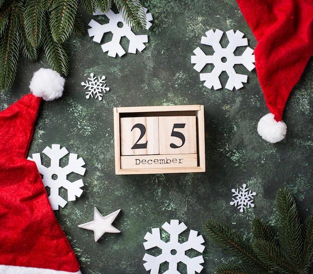 サンタの帽子とクリスマスの背景 Premium写真