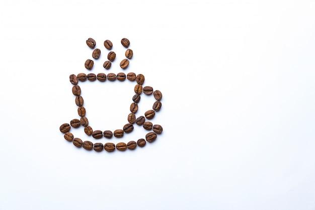 Чашка нарисованная с кофейными зернами Premium Фотографии
