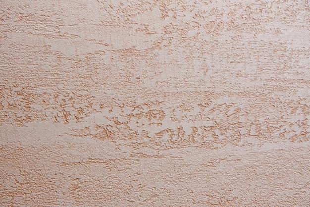 中立的な大まかなベージュの壁の背景。 Premium写真