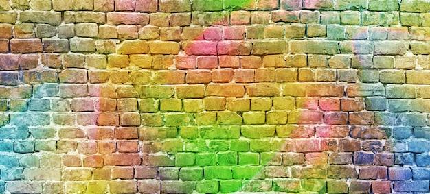 塗られたレンガの壁、抽象的な背景、多様な色 Premium写真