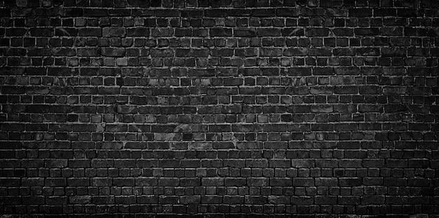 黒レンガの壁の背景 Premium写真