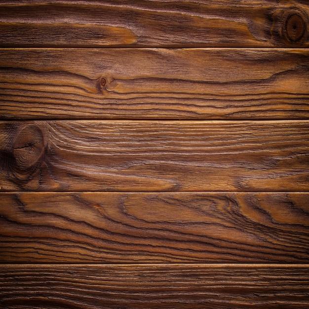 暗い古い木製のテーブルテクスチャ背景のトップビュー Premium写真