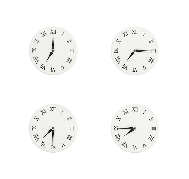 白い背景で隔離のクローズアップ白い時計 Premium写真