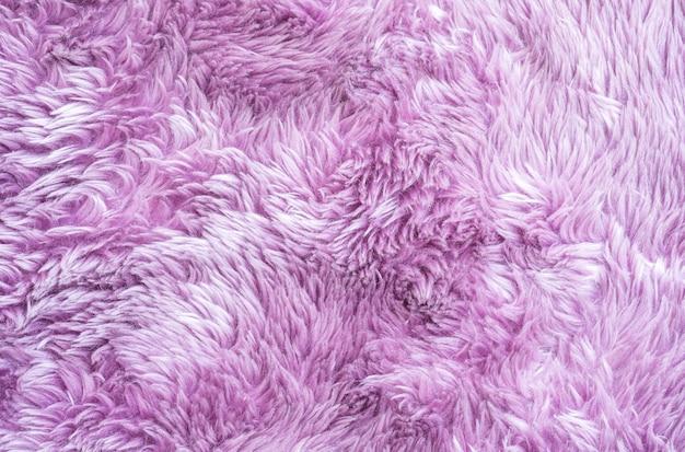 家のテクスチャ背景の床に紫色の布のカーペットでクローズアップ表面抽象的な布パターン Premium写真