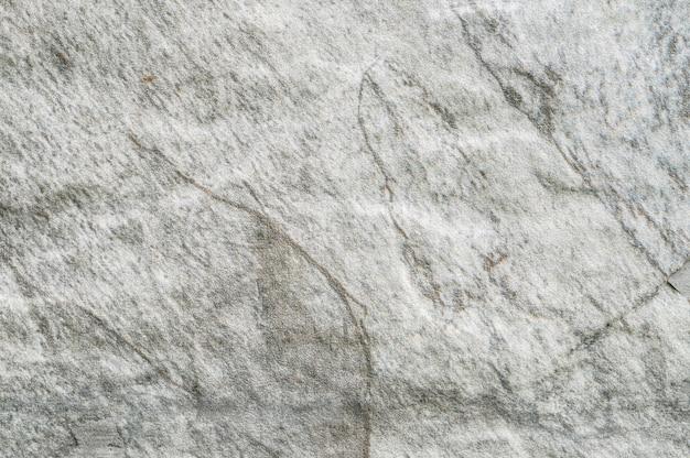 庭の織り目加工の背景に石のレンガの壁に石のパターンでクローズアップ表面 Premium写真