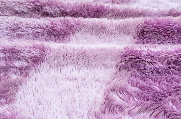床のテクスチャ背景に紫のカーペットでクローズアップ表面抽象ファブリックパターン Premium写真