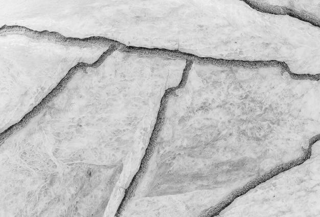 クローズアップの表面割れた大理石の石造りの床のテクスチャ背景 Premium写真