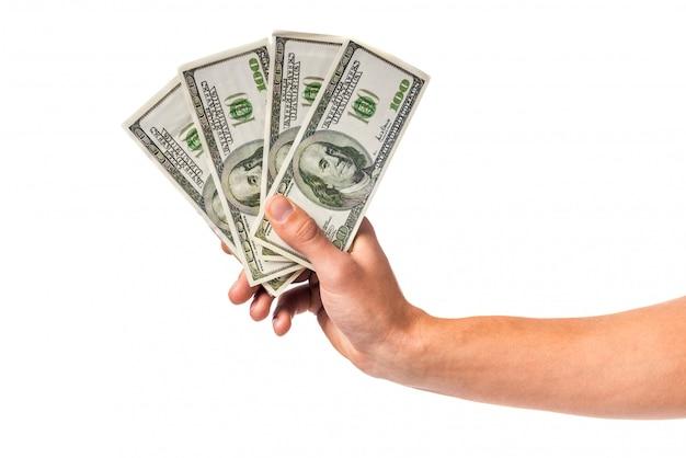 お金の現金を持っている男性の手 Premium写真
