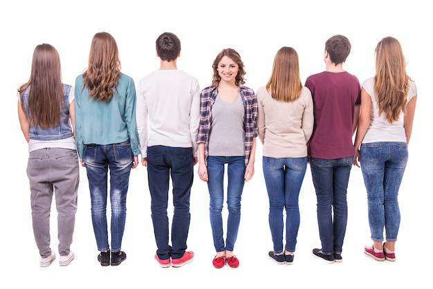 彼の背中で立っている若いグループ Premium写真