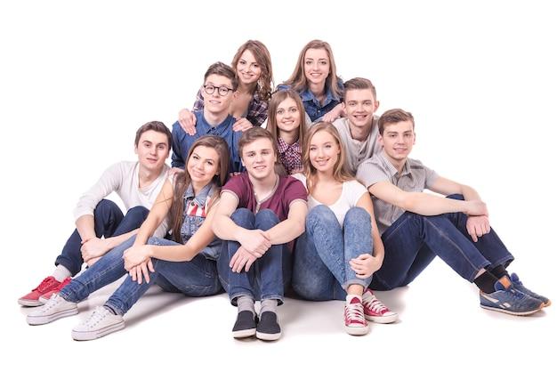 座っている若い十代のグループ Premium写真