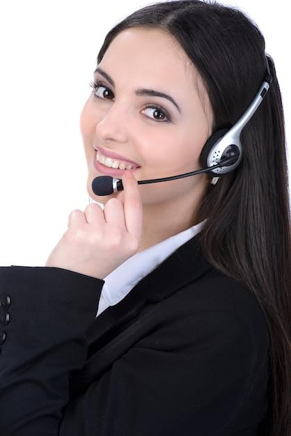 女性顧客サービス担当者、コールセンターの笑みを浮かべてオペレーター。 Premium写真