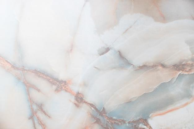 Мраморный оникс. горизонтальное изображение. теплые цвета. Premium Фотографии