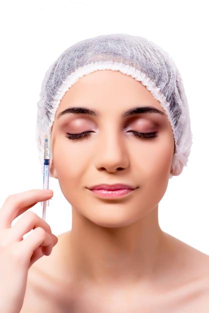 若い女性が白で隔離整形手術の準備 Premium写真