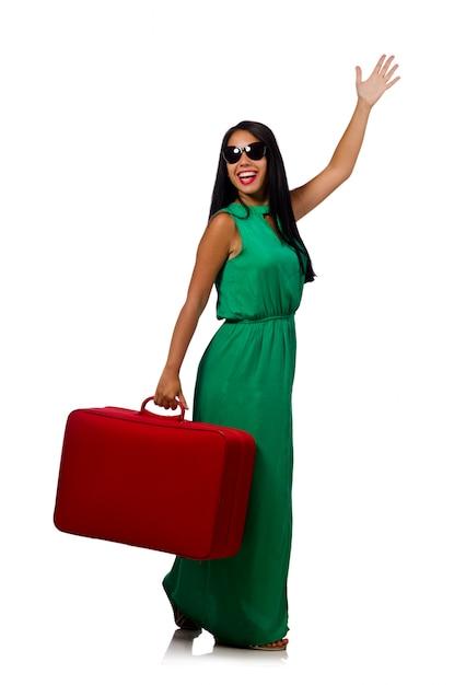 白で隔離されるスーツケースを持つ女性 Premium写真