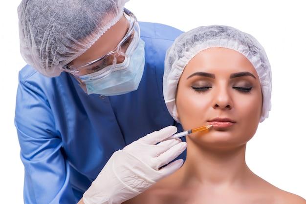 分離されたボトックス注射の準備をする若い女性 Premium写真