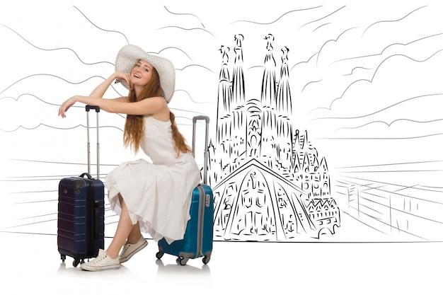 サグラダ・ファミリアを見るためにスペインへ旅行する若い女性 Premium写真
