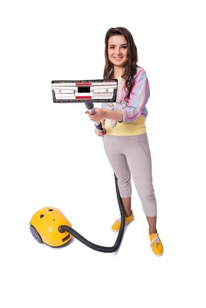 白で隔離掃除機を持つ女性 Premium写真