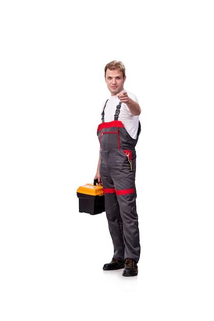 白で隔離つなぎ服を着ている若い建設労働者 Premium写真