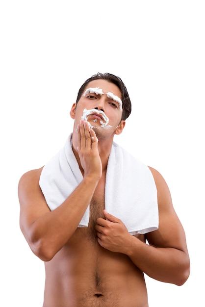 Красивый мужчина бритья на белом фоне Premium Фотографии