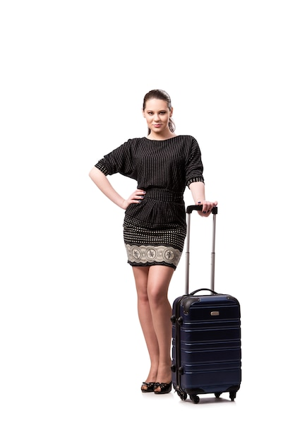 白で隔離されるスーツケースを持つ若い女 Premium写真