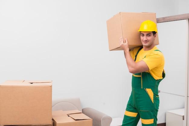 家の移動中にボックスを配達人 Premium写真