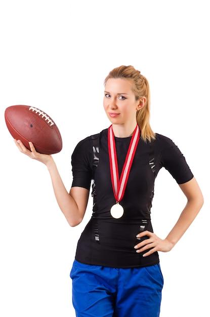 白で隔離アメリカンフットボールを持つ女性 Premium写真