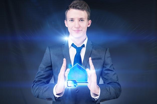 住宅ローンの概念で若いハンサムなビジネスマン Premium写真