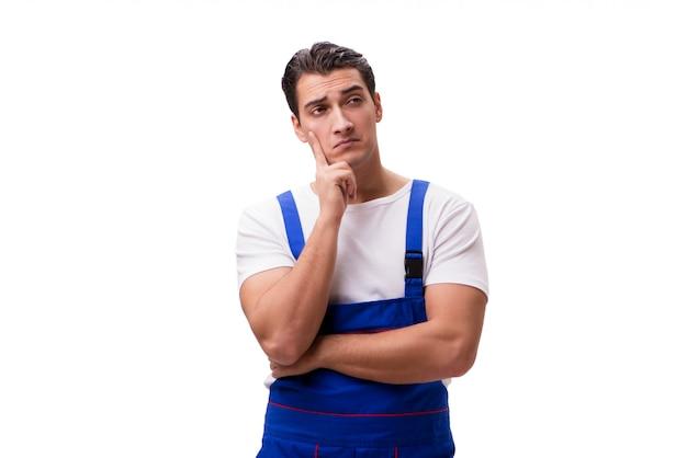 白地に青いつなぎ服を着ているハンサムな修理工 Premium写真