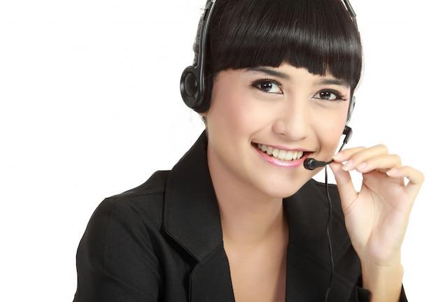 ヘッドセットで幸せな笑顔の陽気なサポート電話オペレーターの肖像画 Premium写真