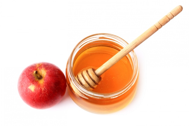 Яблоко и мед изолированные Premium Фотографии