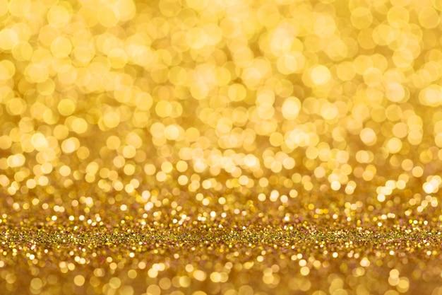 Золотой блеск абстрактный фон Premium Фотографии
