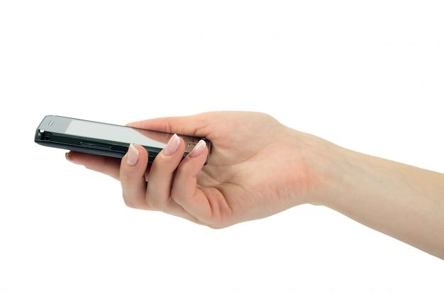 女性の手に携帯電話 Premium写真