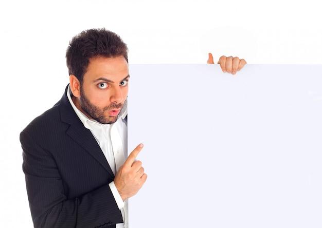 ビジネスマンは看板を示しています Premium写真