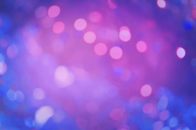 紫色のキラキラクリスマスの質感。 Premium写真