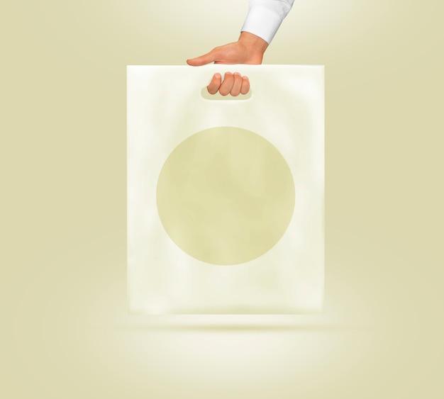 手で保持している空白のビニール袋 Premium写真