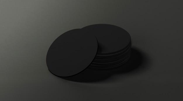 Черные круглые пивные подставки на темной поверхности Premium Фотографии