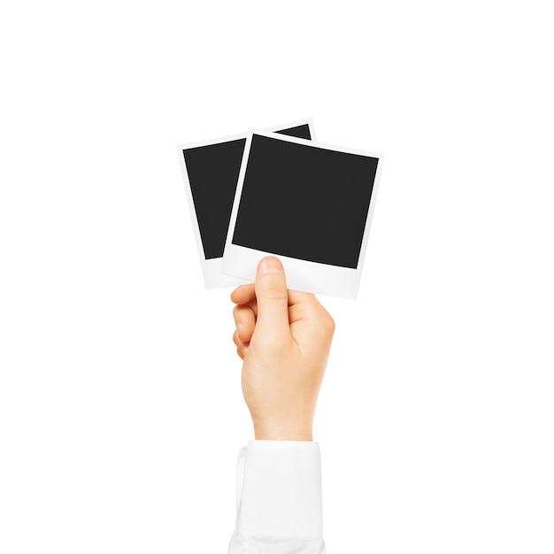分離された空白のフォトフレームモックアップを持っている手 Premium写真