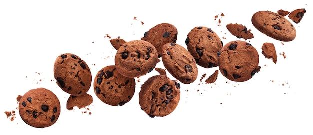 Падая сломанные печенья обломока шоколада изолированные на белизне с путем клиппирования Premium Фотографии