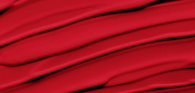 赤いマットの口紅の背景 Premium写真
