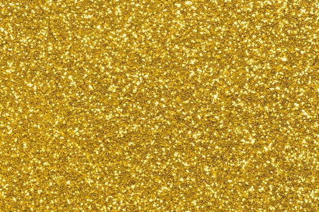 Текстура золотой блеск, праздничные сверкающие огни Premium Фотографии
