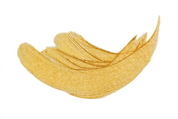 ゴールドペイントまたは白で隔離される金属化粧ストローク Premium写真