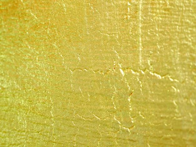 ゴールドカラーの壁の抽象的な背景。 Premium写真