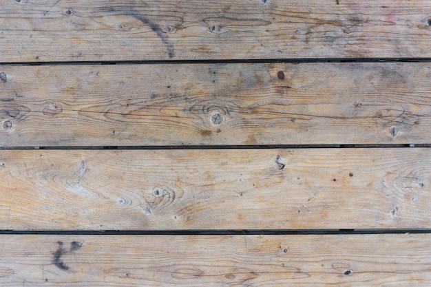スポットと茶色の木製の背景。テクスチャ。 Premium写真