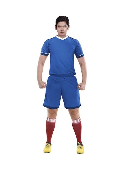 アジアのフットボール選手が立っています。 Premium写真