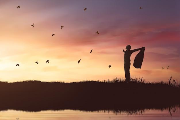 飛んでいる鳥に輝く太陽を楽しんでいるビジネスマンのシルエット Premium写真