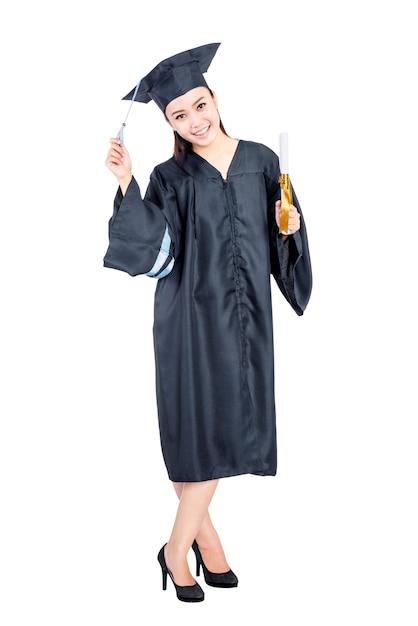 卒業ガウン立っている若いアジア学生女性 Premium写真