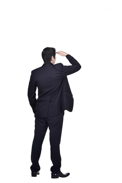 見上げるアジア系のビジネスマンの背面図 Premium写真
